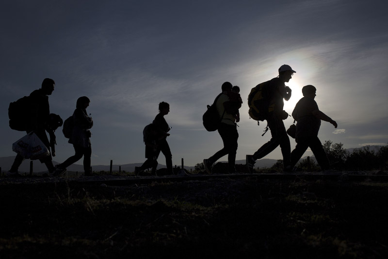 Group of migrants make their way after crossing the Macedonian-Greek border near Gevgelija